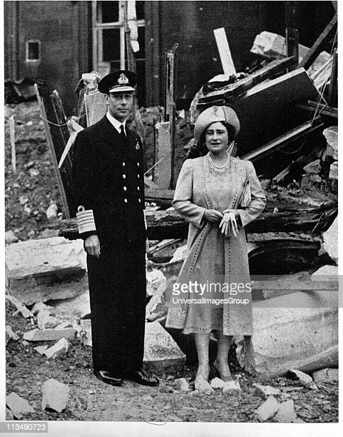 George VI and Queen Elizabeth standing among the bomb damage at Buckingham Palace London During the Blitz the German bombing of London in World War...
