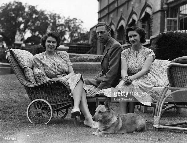 George VI king of Great Britain with his two daughters Princess Elizabeth left and Princess Margaret Rose at the Royal Lodge at Windsor