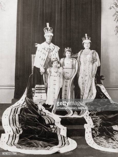 George VI on the day of his coronation with his wife Queen Elizabeth and their daughters Princess Elizabeth, right, and Princess Margaret, left, 12th...