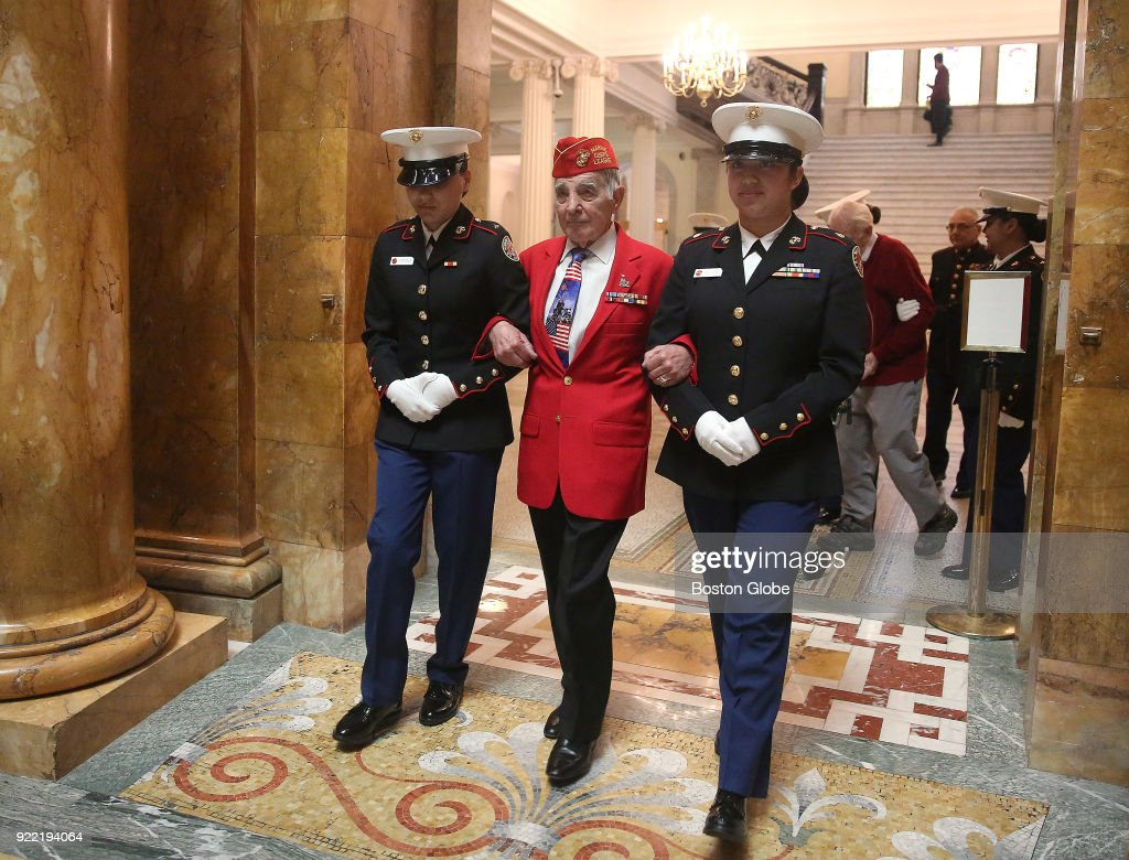 George Vouros, ship's cook 3rd class, 92, is the first of four Iwo Jima veterans escorted into the hall as The Marine Corps League holds its annual Iwo Jima Day observance at the Massachusetts State House in Boston on Feb. 20, 2018.