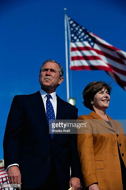 George W Bush and his wife Laura appear at a presidential campaign rally in Dearborn Michigan Bush won the 2000 Presidential Election against Vice...