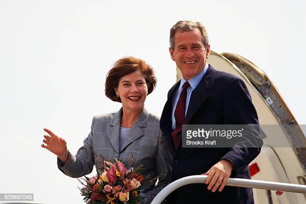 George W Bush and his wife Laura arrive in Cedar Rapids Iowa during the presidential campaign Bush won the 2000 Presidential Election against Vice...