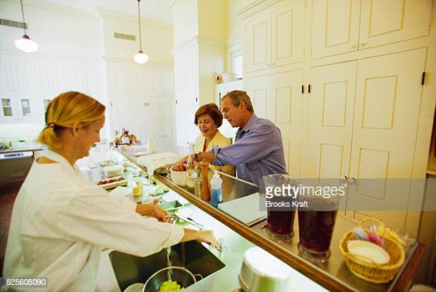 George W Bush and his wife Laura prepare a meal while at the Governor's Mansion in Austin Texas Governor of Texas since 1994 Bush was granted the...