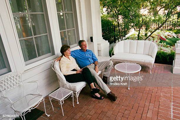 George W Bush and his wife Laura sit on the porch at the Governor's Mansion in Austin Texas Governor of Texas since 1994 Bush was granted the United...