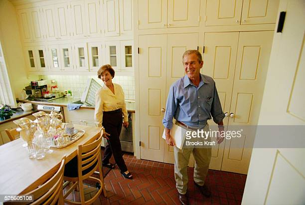 George W Bush and his wife Laura stand in the kitchen of the Governor's Mansion in Austin Texas Governor of Texas since 1994 Bush was granted the...