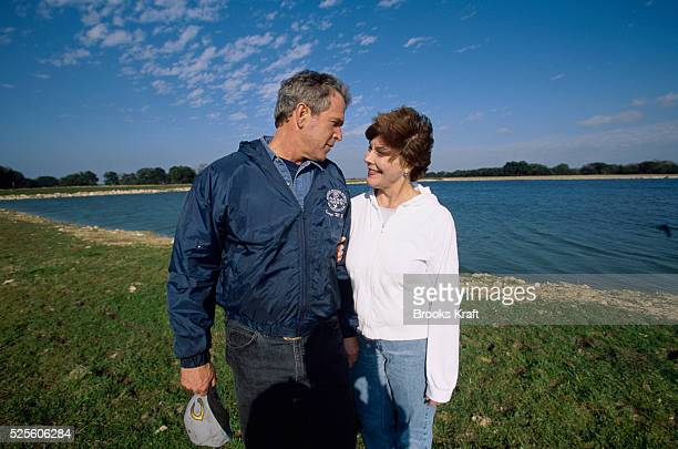 George W Bush and his wife Laura take a stroll on their Texas ranch while awaiting the results of the 2000 Presidential Election recount The...