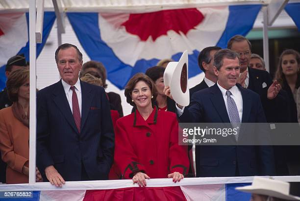 George W Bush attends at his 1994 inauguration as governor of Texas with his wife Laura and his father former president George Bush Bush was elected...