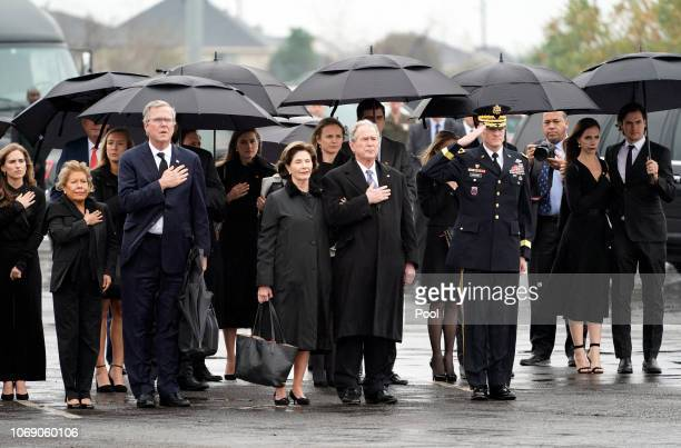 George W Bush Laura Bush and other family members arrive for a departure ceremony as the flagdraped casket of former President George HW Bush is...
