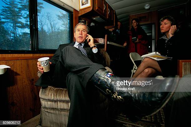George W. Bush rides in his bus while on his presidential campaign tour. Bush won the 2000 Presidential Election against Vice President Al Gore after...