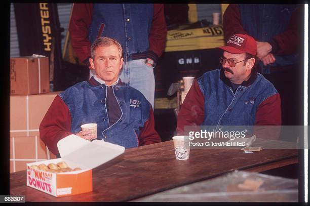 George W Bush sits with a supporter January 18 2000 in Pittsfield NH Bush the eldest son of former US President George Bush served as governor of...