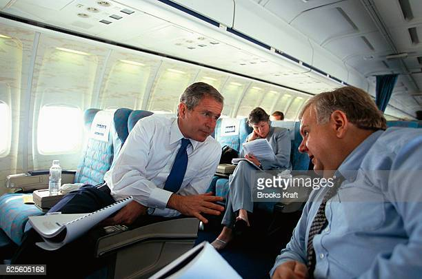 George W Bush talks with advisor Larry Lindsey while on his presidential campaign tour Bush won the 2000 Presidential Election against Vice President...