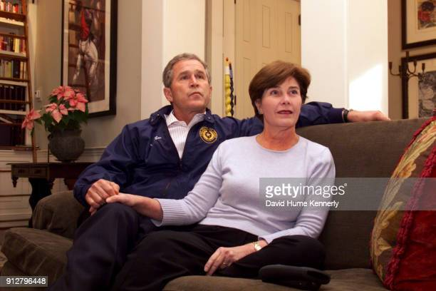 George W Bush with Laura Bush at the Governor's Mansion in Austin Texas on December 12 2000 after learning the Florida Supreme Court ordered a...