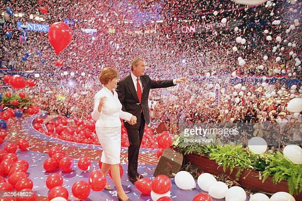 George W Bush with wife Laura on stage at the Republican National Convention after he accepted the party's nomination for US President