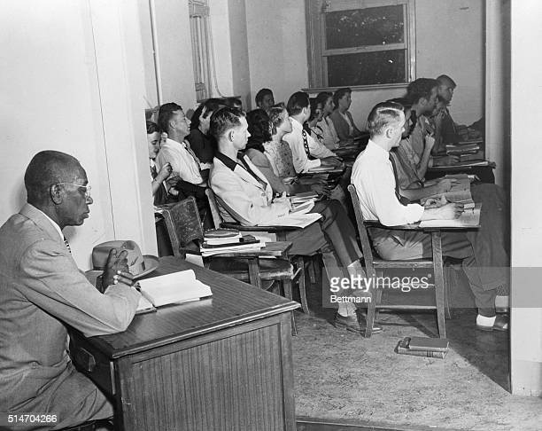 George W. McLaurin, a 54 year old African American, sits in an anteroom, apart from the other students, as he attends class at the University of...