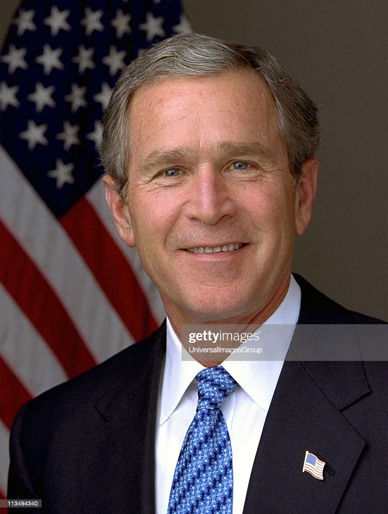 George Walker Bush (born 1946) 43rd President of the United States 2001-2009. 46th Governor of Texas 1995-2000. Head-and-shoulders portrait with stars-and-stripes in background. American Politician Republican. : News Photo