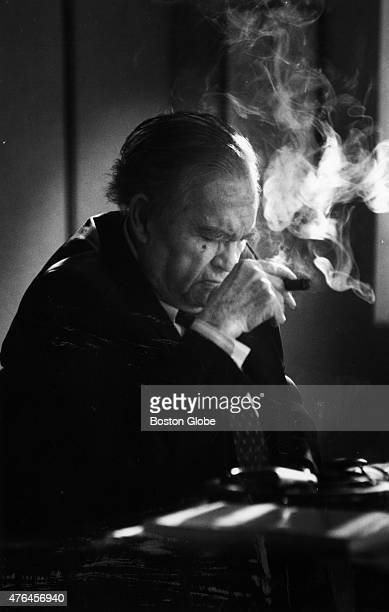 George Wallace the former governor of Alabama smokes a Garcia y Vega cigar his favorite at his desk on the fourth floor of Bartlett Hall part of the...