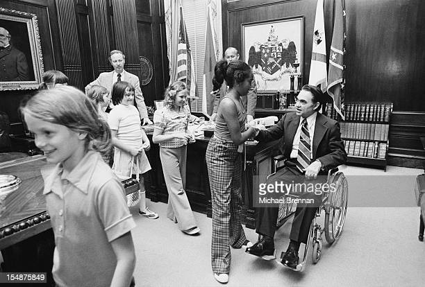 George Wallace the Governor of Alabama meets children of differing racial backgrounds in Birmingham Alabama March 1975 Wallace is known for his...