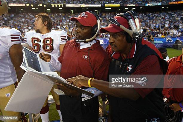 George Warhop meets with Bishop Harris of the San Francisco 49ers during the preseason game against the San Diego Chargers on September 1 2005 at...