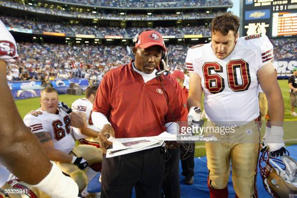 George Warhop meets with Brendan Darby of the San Francisco 49ers during the preseason game against the San Diego Chargers on September 1 2005 at...
