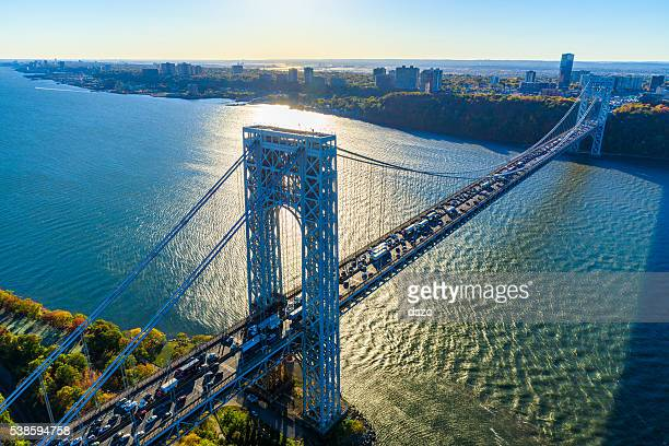 george washington bridge, nyc, rush hour, view from helicopter, silhouette - new jersey stock pictures, royalty-free photos & images