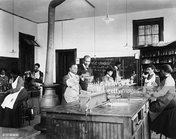 George Washington Carver with students in his laboratory at Tuskegee Institute Undated photograph