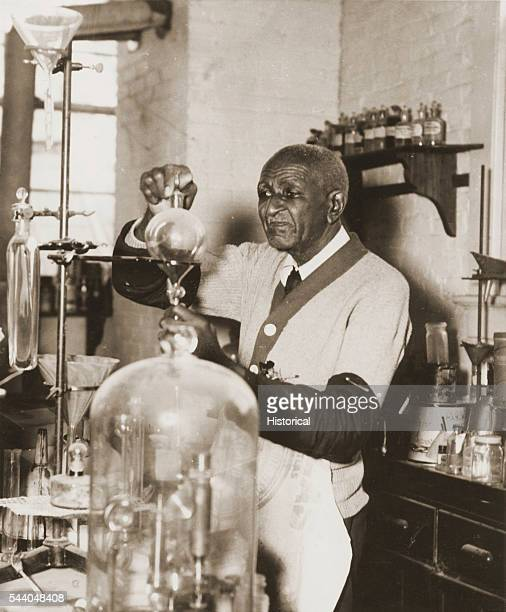 George Washington Carver working with chemistry equipment in his laboratory at Tuskegee University photograph from the Tuskegee University Archives
