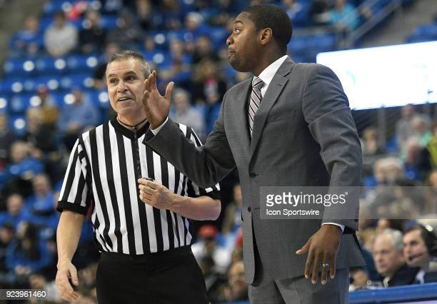George Washington Coach Maurice Joseph discusses a call with an official during an Atlantic 10 Conference basketball game between the George...