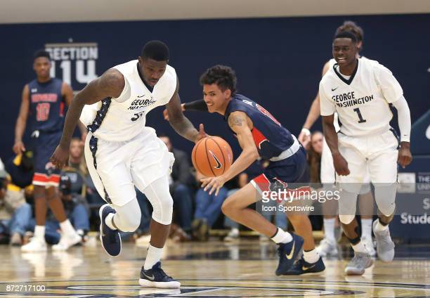 George Washington Colonials forward Bo Zeigler races away from Howard Bison guard Kyle Foster during a men's college basketball game between the...