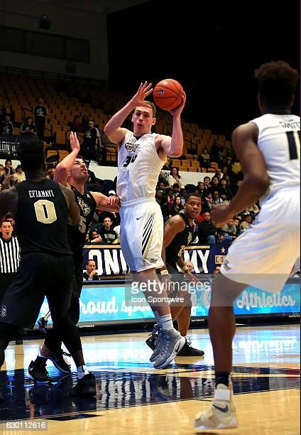 George Washington Colonials forward Tyler Cavanaugh sends a pass to forward Arnaldo Toro during a NCAA men's Div 1 basketball game on December 15 at...