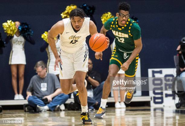 George Washington Colonials guard DJ Williams moves away from George Mason Patriots forward AJ Wilson during an Atlantic 10 men's basketball game...