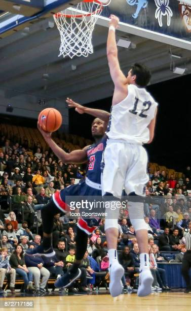 George Washington Colonials guard Yuta Watanabe defends against Howard Bison guard Dalique Mingo during a men's college basketball game between the...