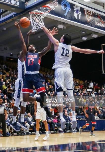George Washington Colonials guard Yuta Watanabe defends against Howard Bison forward Charles Williams during a men's college basketball game between...