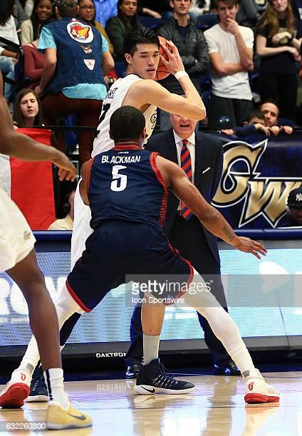 George Washington Colonials guard Yuta Watanabe holds the ball away from Duquesne Dukes guard Emile Blackman during an Atlantic 10 men's basketball...