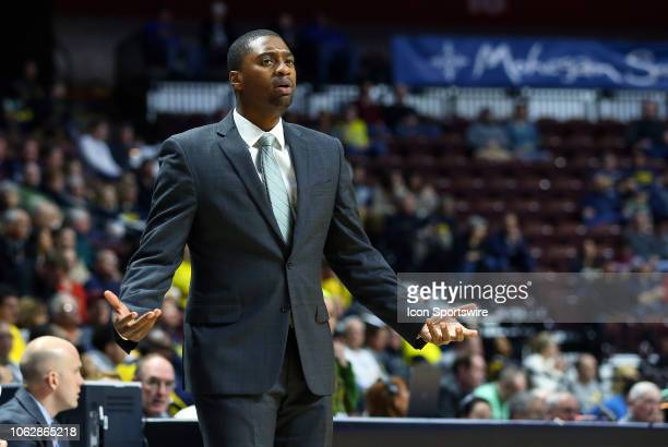 George Washington Colonials head coach Maurice Joseph reacts during a college basketball game between Michigan Wolverines and George Washington...