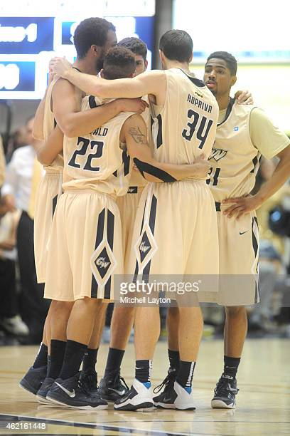 George Washington Colonials huddle during a college basketball game against the Richmond Spiders at the Smith Center on January 15 2015 in Washington...