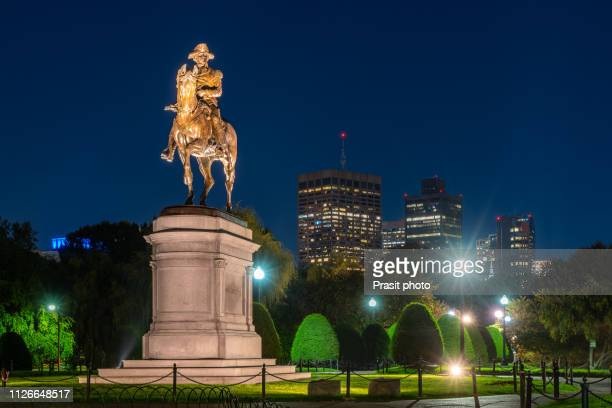 george washington equestrian statue at public garden at night in boston, massachusetts, usa. - boston common stock pictures, royalty-free photos & images