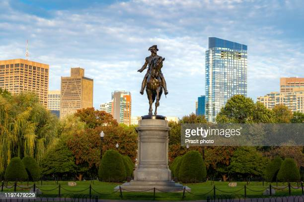 george washington equestrian statue at public garden with office business building downtown district in boston, massachusetts, usa. usa tourism, modern city life, or business finance and economy concept - boston common stock pictures, royalty-free photos & images