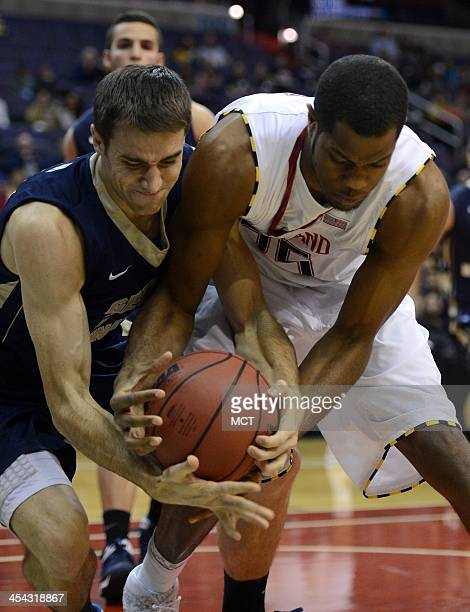 George Washington forward John Kopriva left and Maryland forward Damonte Dodd battle for loose ball along the baseline in the first half of an NCAA...