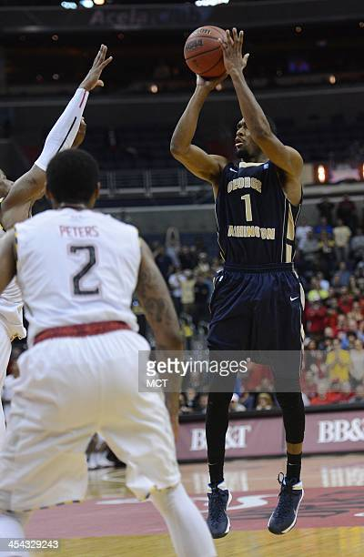 George Washington guard Maurice Creek shoot the gamewinning shot over the outstretched arm of Maryland guard Nick Faust with less than a second to go...