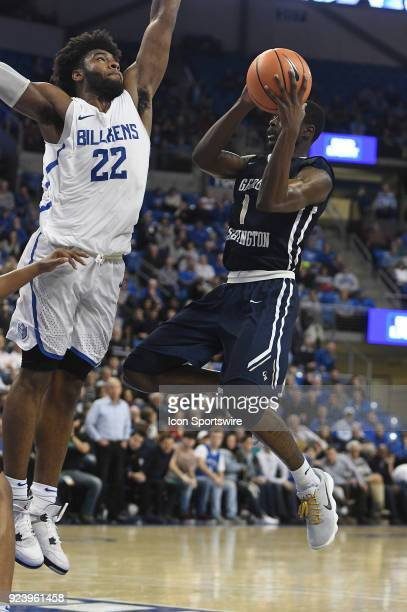 George Washington guard Terry Nolan drives in for a shot over Saint Louis forward Hasahn French during an Atlantic 10 Conference basketball game...