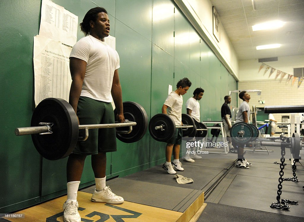 DENVER, CO--SEPTEMBER 16TH 2010-- George Washington High School football player, Elijah Ruff, left, DT/OT, first winner of the Denver Broncos Brian Dawkins Award lifting weights with his teammates at George Washington Thursday afternoon. Andy Cross, The D : News Photo