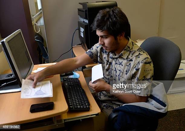 George Washington High School senior Edgar Gutierrez prepares a project on tropospheric ozone for one of his IB science classes Gutierrez is applying...