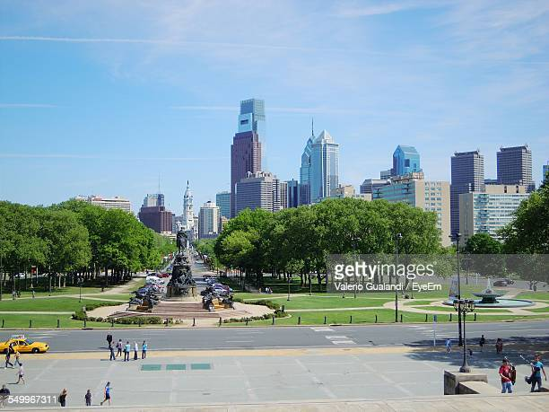 George Washington Monument At Eakins Oval With Urban Skyline In Background
