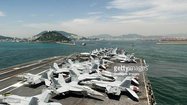 uss george washington prepares to enter the harbor in korea. - uss george washington stock photos and pictures