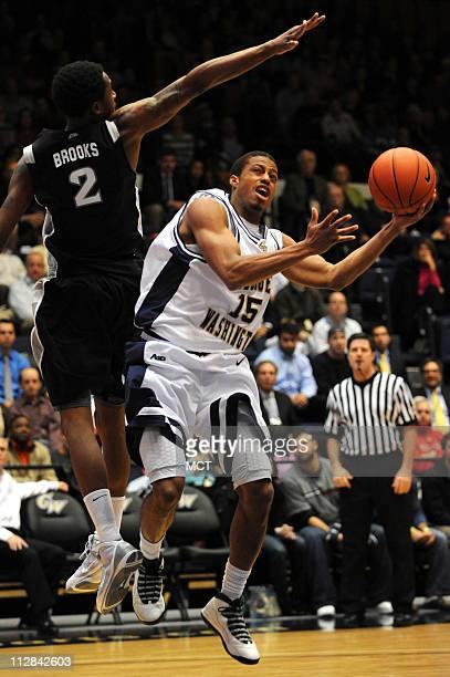 George Washington University guard Aaron Ware puts a shot up against Providence defender Marshon Brooks during the second half at the Charles E Smith...