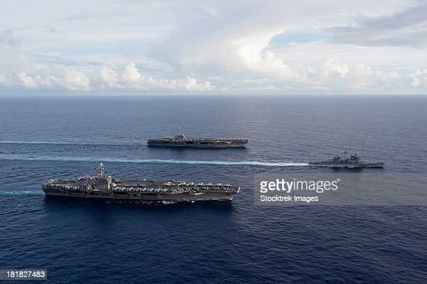 uss george washington, uss john c. stennis, and uss mobile bay. - uss george washington stock photos and pictures