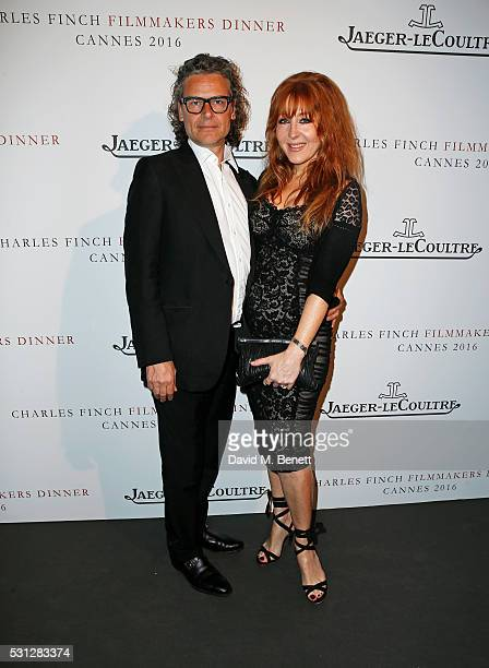 George Waud and Charlotte Tilbury attend The 8th Annual Filmmakers Dinner hosted by Charles Finch and JaegerLeCoultre at Hotel du CapEden Roc on May...