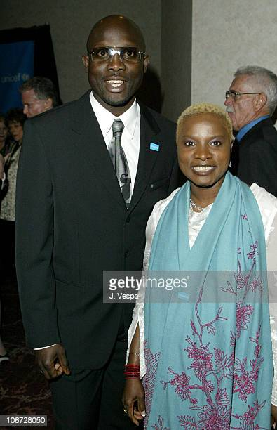 George Weah and Angelique Kidjo during UNICEF Goodwill Gala Celebrating 50 Years of Celebrity Goodwill Ambassadors Backstage and Audience at Beverly...