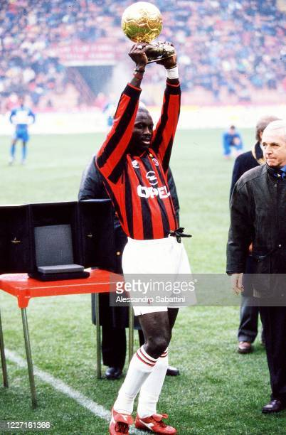 George Weah of AC Milan celebrates in Milan after winning the golden ball during the Serie A at Stadio Giuseppe Meazza in Milan, Italy. , Italy.