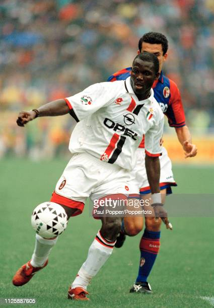 George Weah of AC Milan in action during the Serie A match between Bologna and AC Milan at the Stadio Renato Dall'Ara on September 22 1996 in Bologna...